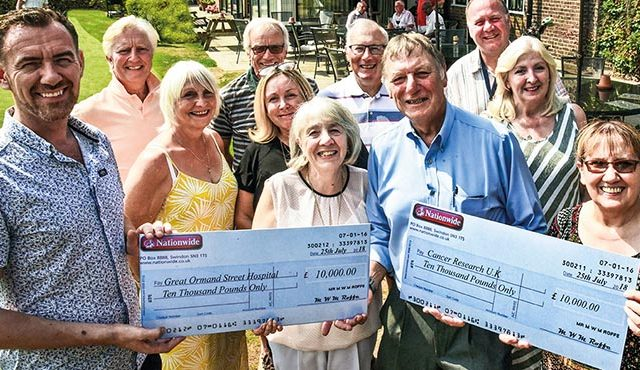 The captain of Wanstead Golf Club in north-east London has handed over two cheques to national charities